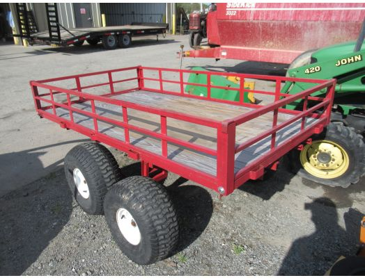 Red 4x7 tandem axle trailer